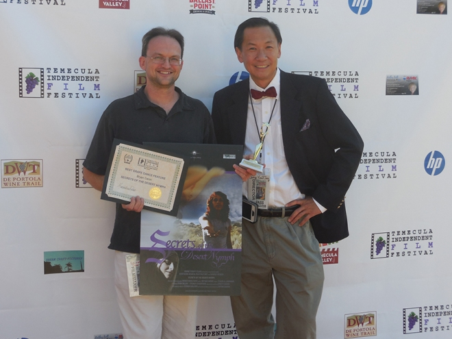 Me (alongside festival director Gary Vinant-Tang) showing off the award for Best Grape Dance Feature at the Temecula Independent Film Festival